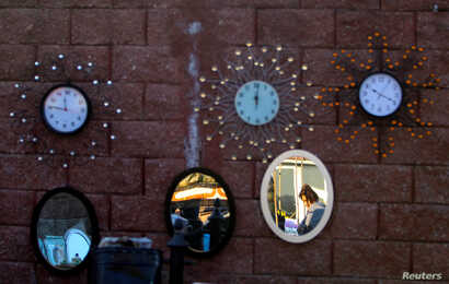 A vendor sells clocks and mirrors in Suto Orizari, a district with Europe's largest Roma communities, Macedonia, Dec. 2, 2016.
