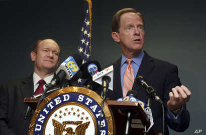 FILE - U.S. Sen. Pat Toomey, R-Pa., right, speaks during a press conference alongside U.S, Sen. Chris Coons, D-Del., in Philadelphia, March 5, 2018.