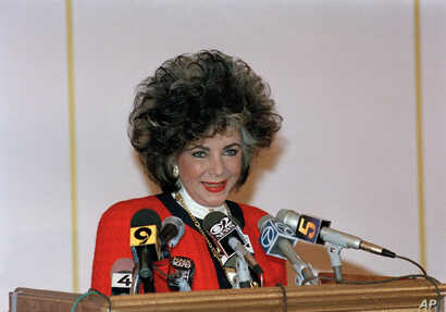 Actress Elizabeth Taylor announces a fund-raiser to benefit AIDS research and education during a news conference in West Hollywood, Calif., Jan. 9, 1986.