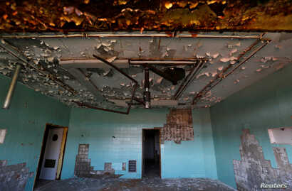 A room of a surgery department of a former Soviet military hospital, which lies derelict since 1991 when the last Russian troops left Hungary, is seen in Budapest, Hungary, May 22, 2017.
