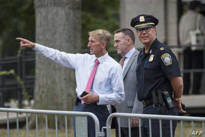 "Boston Police Commissioner William Evans, left, with other officers along barricades on the Boston Common where a ""Free Speech"" rally is scheduled and a large rally against hate in solidarity with victims of Charlotestville will converge on Aug.18, 2..."