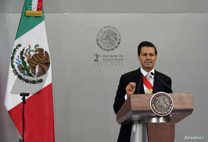 Mexico's President Enrique Pena Nieto addresses the audience during his second State of the Union address at the National Palace in Mexico City, Sept. 2, 2014.