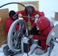 Near U.S. Antarctic McMurdo station scientists practice lowering the ocean profiler down a hole into the ocean beneath the ice.