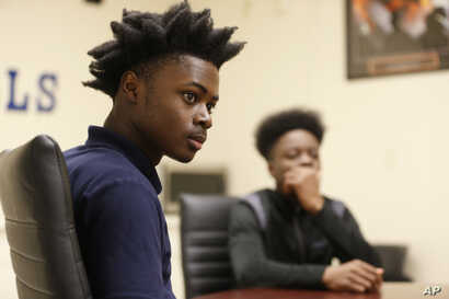 """Larry Anderson, left, and Kamal Ani-Bello, both Miami Northwestern Senior High School students who acted in the movie """"Moonlight,"""" speak during an interview with The Associated Press in Miami, Feb. 27, 2017."""