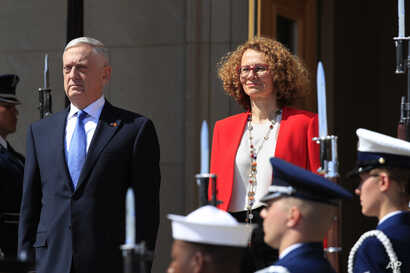 Secretary of Defense Jim Mattis and Macedonian Defense Minister Radmila Sekerinska, right, stand at attention during a ceremony welcoming Sekerinska at the Pentagon, May 1, 2018.