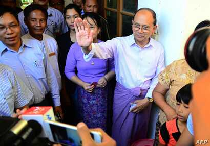 Myanmar's President Thein Sein (L) leaves after casting his vote in Naypyidaw on Nov. 8, 2015.