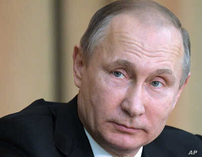 FILE- Russian President Vladimir Putin attends a meeting with Russian prosecutors in Moscow, Russia.