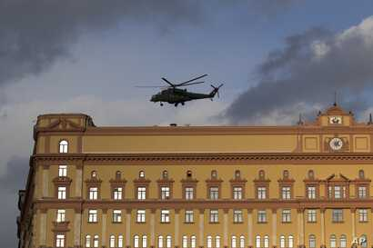 FILE - A Russian military Mi-35 helicopter takes off from the building of Russia's Federal Security Service, the successor agency of the Soviet-era KGB, in Lubyanskaya Square in Moscow, Russia, Feb. 26, 2016.