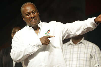 Ghana Incumbent President, John Dramani Mahama candidate of the National Democratic Congress gestures to his supporters during a presidential election rally at Accra Sports Stadium in Accra, Ghana, Dec. 5, 2016.