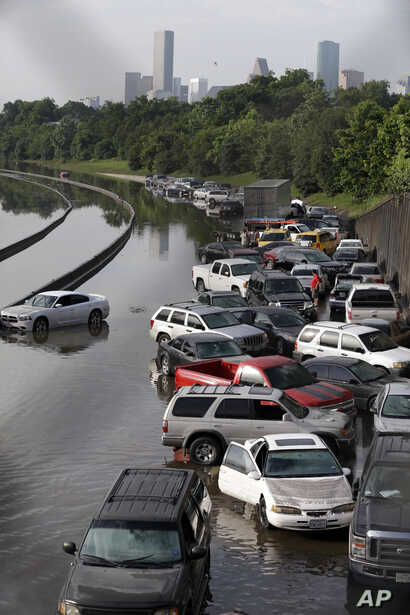 FILE- Cars remain stranded along a flooded section of Interstate 45 after heavy rains overnight in Houston, May 26, 2016. Flooding caused by heavy rains in and around Houston in the past month has killed nearly a dozen people.