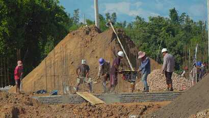Construction workers building a condominium at the site of the Chinese resort town on the outskirts of Shwe Koko in Karen state, Myanmar.