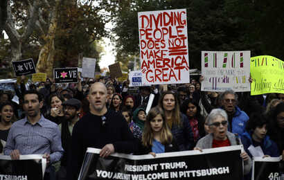 Protesters demonstrate near Pittsburgh's Tree of Life Synagogue where President Donald Trump and first lady Melania Trump were visiting a memorial in Pittsburgh, Oct. 30, 2018.