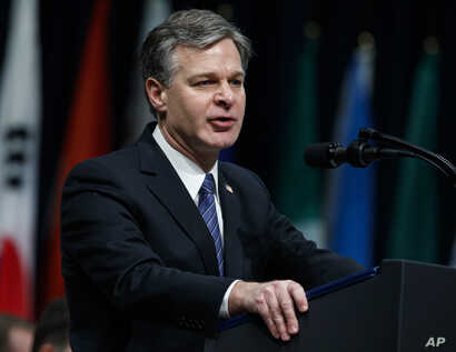 FILE - FBI Director Christopher Wray speaks during the FBI National Academy graduation ceremony, Dec. 15, 2017, in Quantico, Va.