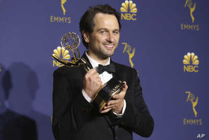"""Matthew Rhys poses in the press room with the award for outstanding lead actor in a drama series for """"The Americans"""" at the 70th Primetime Emmy Awards, Sept. 17, 2018, at the Microsoft Theater in Los Angeles."""