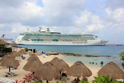 The cruise ship Brilliance of the Seas is docked in the waters of Cozumel, Mexico, March 19, 2016. The U.S. Coast Guard said the ship picked up 18 Cuban migrants near Marco Island, Florida.