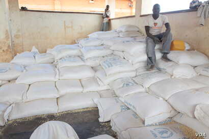 Bags of maize ready for distribution at Dzaleka refugee camp in Malawi (photo taken by Lameck Masina).