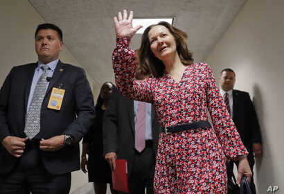 Gina Haspel, President Donald Trump's nominee to become CIA director, waves as she arrives for her meeting with Sen. Joe Manchin, D-W.Va., on Capitol Hill in Washington, May 7, 2018.