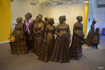 The First Wave statue exhibit in the lobby of the Visitor Center features Elizabeth Cady Stanton at the far left.