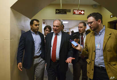 FILE - Sen. Tim Kaine (Democrat-Virginia) speaks to reporters on Capitol Hill in Washington, Sept. 25, 2018.