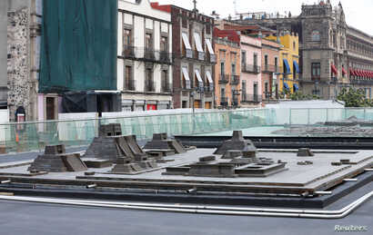 A model of the major structures of the ceremonial precinct of the Aztec capital of Tenochtitlan, including the temple to the wind god and ball court, as seen outside the ruins of the Templo Mayor in downtown Mexico City, Mexico, June 7, 2017.