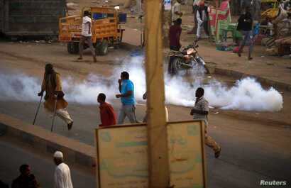 A tear gas canister fired to disperse Sudanese demonstrators, during anti-government protests in the outskirts of Khartoum, Sudan, Jan. 15, 2019.