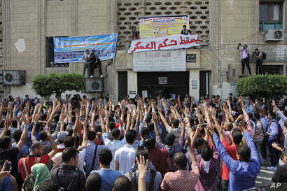 Student protesters hold a rally at Cairo University in Cairo, Egypt, Sunday, Oct. 12, 2014.
