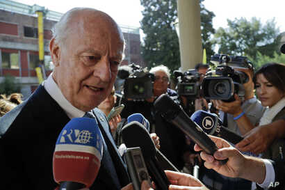 UN Special Envoy for Syria Staffan de Mistura talks with journalists as he arrives at a conference on the situation in Syria and Iraq held by Catholic charities operating in those regions, at the Vatican, Sept. 29, 2016.