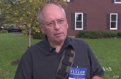 Democrat Roger Fuller, a first-time candidate for Maine's House of Representatives, campaigns door to door to meet voters.
