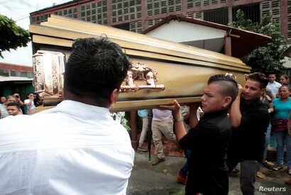 Relatives carry the coffin of Orlando Cordobas, 15, who was shot during recent protests against Nicaraguan President Daniel Ortega's government in Managua, Nicaragua, June 1, 2018.