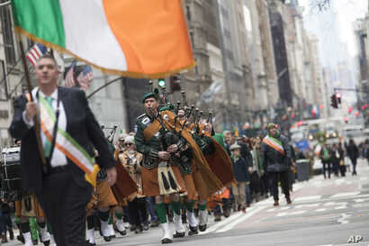 Bagpipers march up Fifth Avenue during the St. Patrick's Day Parade, March 16, 2019, in New York.