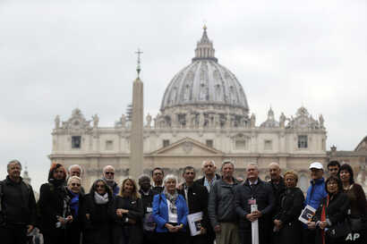 Members of the ECA (Ending of Clergy Abuse) organization and survivors of clergy sex abuse pose for photographers outside St. Peter's Square, at he Vatican, Feb. 18, 2019.