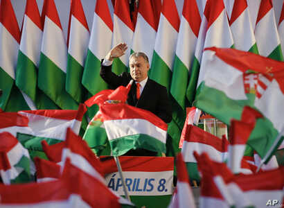 Prime Minister Viktor Orban waves during the final electoral rally of his Fidesz party in Szekesfehervar, Hungary.