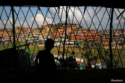 View of temporary shelters is seen through the shelter at Palong Khali refugee camp, near Cox's Bazar, Bangladesh,  Nov. 14, 2017.