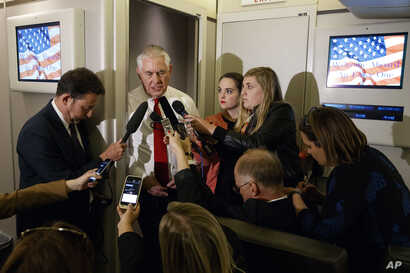 Secretary of State Rex Tillerson speaks with reporters on a flight with President Donald Trump to Israel, May 22, 2017, aboard Air Force One.