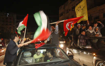 Palestinians celebrate the U.N. General Assembly votes on a resolution to upgrade the status of the Palestinian Authority to a nonmember observer state, Gaza City, November 29, 2012.