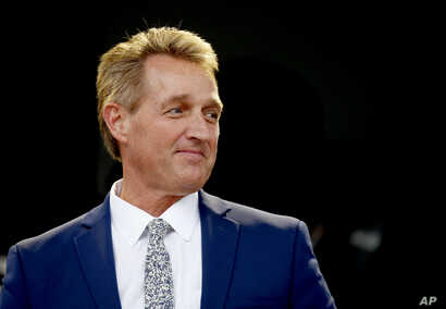 Sen. Jeff Flake, R-Ariz., looks on during an appearance at the Forbes 30 Under 30 Summit, Oct. 1, 2018, in Boston.