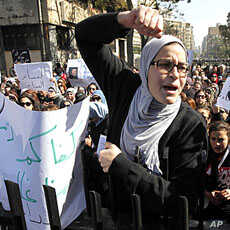 Women chant anti-military council slogans during a protest near the People's Assembly building in Cairo February 5, 2012.
