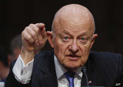 FILE - In this May 8, 2017, file photo, former National Intelligence Director James Clapper testifies on Capitol Hill in Washington, before the Senate Judiciary subcommittee on Crime and Terrorism.