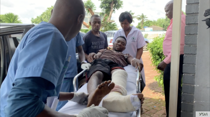 A citizen arrives at a private medical center in Harare, Jan. 17, 2019, after he was injured during this week's protests. Human rights organizations accuse the army of brutally crushing the protests, an accusation the government vehemently denies. ...