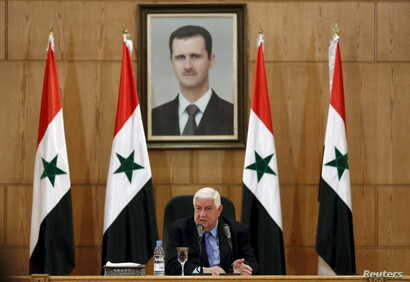 Syria's Foreign Minister Walid Muallem speaks during a news conference in Damascus, Syria, March 12, 2016.