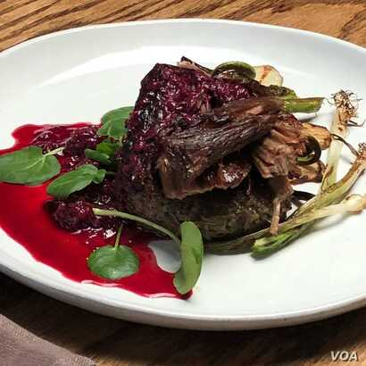 "A dish created by Lakota ""Sioux Chef"" Sean Sherman, which features elk, wild rice, fern fiddlehead, berries, spring onion and sunchoke."