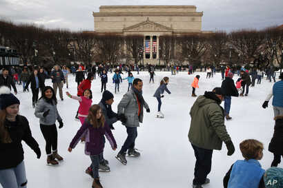 People skate on the National Gallery of Art Sculpture Garden Ice Rink, Dec. 27, 2018, as a partial government shutdown continues in Washington. The museum and the skate rink will be closed to the public after Jan. 2 as a result of the shutdown if it ...