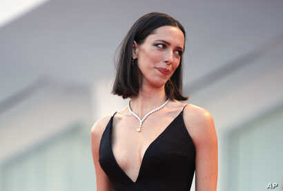 FILE - Actress Rebecca Hall poses for photographers at the Venice Film Festival in Venice, Italy, Sept. 5, 2017.
