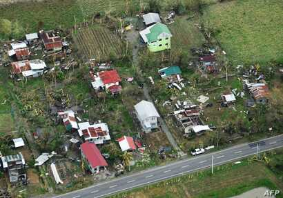 An aerial photo shows houses destroyed at the height of Typhoon Mangkhut in Alcalá, in Cagayan province, Sept. 16, 2018. Mangkhut slammed into the northern Philippines with violent winds and torrential rains, as authorities warned millions in its pa...