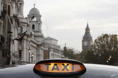 A taxi sign on a vehicle during a protest by drivers who blocked streets in London, Tuesday, Nov. 8, 2016.