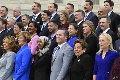 Members of the freshman class of Congress pose for a photo opportunity on Capitol Hill in Washington, Nov. 14, 2018.