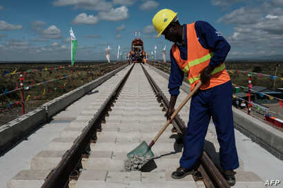 FILE - A Kenyan worker puts gravel at the construction site of Standard Gauge Railway (SGR) in Nairobi, Kenya, June 23, 2018.