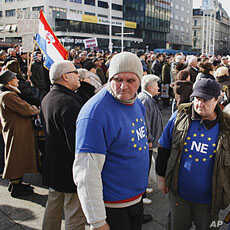 Croatian anti-EU protesters rally in the central square of Zagreb Saturday, January 21, 2012.