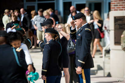 Students from the Infantry Basic Officer Leader Course Class 07-16 celebrate with their families and fellow classmates after graduation, at Fort Benning, Georgia, Oct. 26, 2016. Ten U.S. Army women were the first women graduated from the military bra...