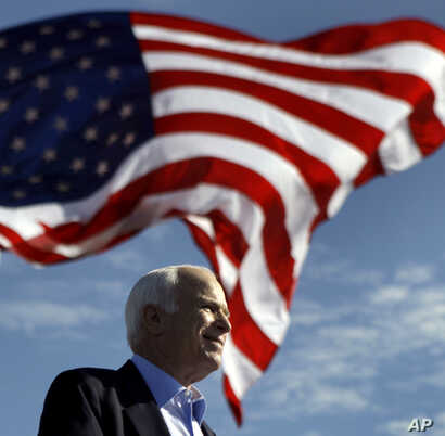 FILE - Republican presidential candidate Sen. John McCain, R-Ariz. speaks at a rally outside Raymond James Stadium in Tampa, Florida, Nov. 3, 2008.